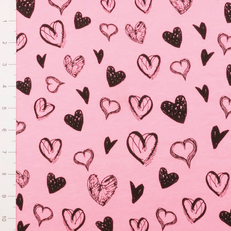 Black Hearts on Coral Pink Light Weight Jersey Knit Fabric