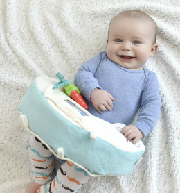 Snuggwugg helps stop wiggly diaper changes.