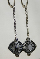 long dangle clear and black lampworked crystal shaped earrings