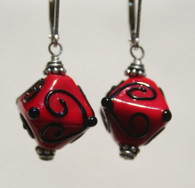 Red lampworked crystal shaped earrings with black accents