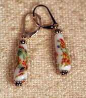 "White teardrop shaped ""millefiori"" glass earrings"
