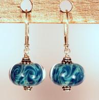 Swirled seafoam and teal waves