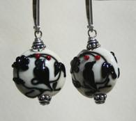 Black dove lampworked lentil shaped earrings