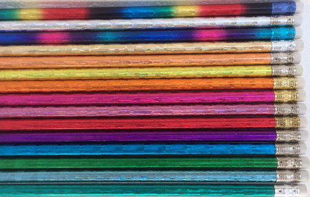 Assorted Glitz pencils sold by individual color or in assortments.  Available colors include: silver, gold, copper, orange, yellow, light pink, magenta, red, purple, royal blue, light blue, turquoise, green, rainbow and spectrum (magenta, purple and royal blue combination).