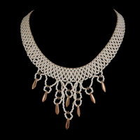 Netted bridal collar in white beads with gold dagger drops, Swarovski crystals, and pearl closure