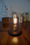Nice looking Bell jar on a wooden base wired as a table light.