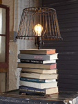 Turn a stack of books into a table lamp, we show you how.