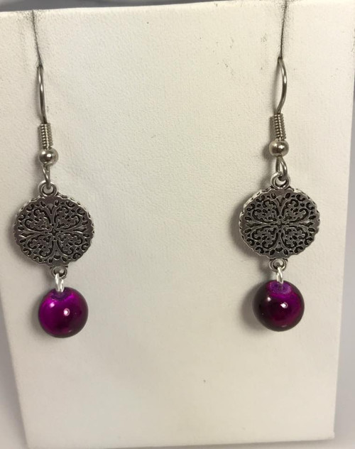 Resell for 6.00 or more  Pewter disc with glass bead  Surgical steel ear wires