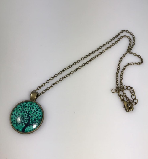 Resell for 9.00 or more Antiqued brass chain  18 inch plus ext Glass tree of life  teal and navy Style #BTN101917g