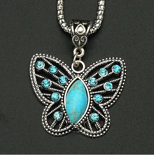 resell for 12.00 or more Pewter Butterfly with blue crystal and turquoise magnesite 22 inch silver tone chain with ext Style #TMBN113017g
