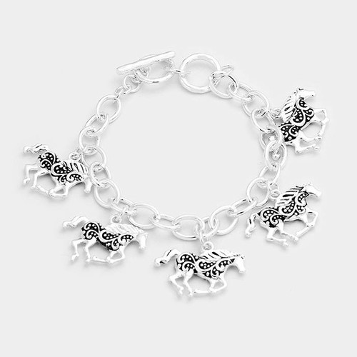 "resell for 36.00 or more • Color : Antique Silver • Theme : Animal  • Size : 1"" H • Total Size : 7"" + 1"" L • Toggle Closure • Material : Lead and nickel compliant • Antique Metal Horse Charms Station Bracelet Style #HCB120417g"