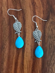 Resell for 8.00 or more Pewter angel wing Reconstituted turquoise bead Surgical steel ear wires Style #TPAWE012618g