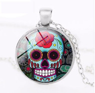 resell for 12.00 or more Sugar Skull Day of Dead Necklace Red Rose Skully 20 inch silvertone chain, 2 inch extender glass pendant measures approx 1 inch Style # RRDDN020118g