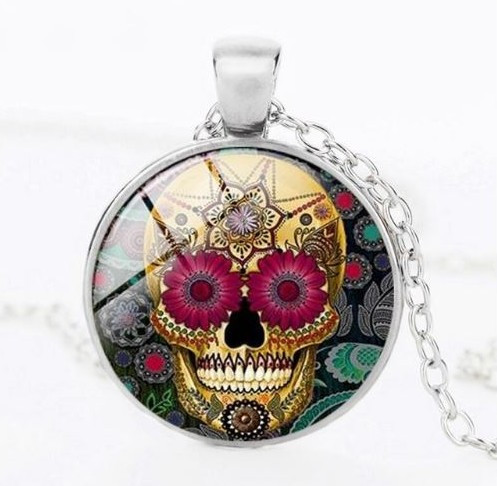 resell for 12.00 or more Sugar Skull Day of Dead Necklace Pink Flower eyes. 20 inch silvertone chain, 2 inch extender glass pendant measures approx 1 inch Style #FEDDN020118g