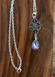 Resell for 12.00 or more 20 inch silver tone chain. Ornate scrolled pendant with lavender crystal is 2 inches Style #LCBN022318g