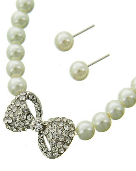 """resell for 27.00 or more Silver Tone / White Synthetic Pearl & Clear Rhinestone / Lead Compliant / Post (earrings) / Bow Tie / Necklace & Earring Set  •   LENGTH : 18"""" + EXT •   PENDANT : 1"""" X 3/4"""" •   EARRING : 5/16"""" DIA  •   SILVER/WHITE Style #CBWPS022718g"""