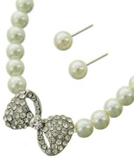 "resell for 27.00 or more Silver Tone / White Synthetic Pearl & Clear Rhinestone / Lead Compliant / Post (earrings) / Bow Tie / Necklace & Earring Set  •   LENGTH : 18"" + EXT •   PENDANT : 1"" X 3/4"" •   EARRING : 5/16"" DIA  •   SILVER/WHITE Style #CBWPS022718g"