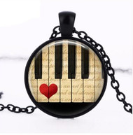 resell for 12.00 or more 20 inch black enamel coated chain, plus ext musis, piano, heart. glass dome. Style #PKHN031518g