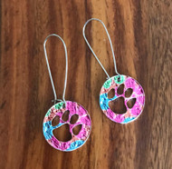 Resell for 18.00 or more Pewter and Mylar. Variances in color make these unique  Approx 2 1/4 inch long Stainless steel earwires Paw prints/ bright multi Style #MPPE041218