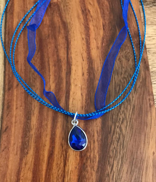 Resell for 12.00 or more Royal blue organza with cord 17.5 inch plus ext Royal blue faceted glass pendant Style #RBCPN041318
