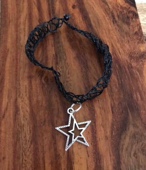 Resell for 9.00 or more Plastic stretch choker Pewter star Style #BCSN041318