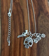 Resell for 12.00 or more 20 inch ball chain plus ext Pewter skull, gun, motorcycle charms Style #SMGPN042718
