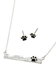 "resell for 45.00 or more Silver Tone / Black Epoxy / Lead&nickel Compliant / Metal / Post (earrings) / Paw Print / Delicate / Necklace & Earring Set  •   LENGTH : 15 3/4"" + EXT •   PENDANT : 1 5/8"" X 1/4"" •   EARRING : 1/4""	 •   SILVER/BLACK  Style #BPPNS050718"
