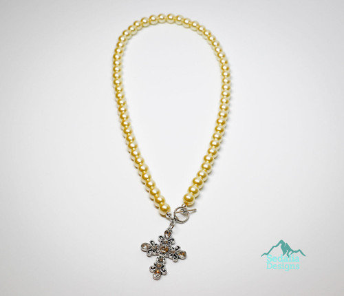 resell for 60.00 or more 18 inch ivory glass pearl necklace  1.5 inch pewter with crystal cross Front toggle clasp Style #CCPN051418