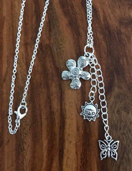 Resell for 15.00 or more 29 inch silver tone chain  Pewter flower, sunshine and butterfly Style #FBSCN053118