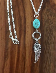 "Resell for 15.00 or more 20 inch silver tone chain Pewter angel wing w rose design/ turquoise magnesite. Pendant is 3 2/8"" Style #TAWPN062218"