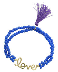 """resell for 9.00 or more Gold Tone / Blue Acrylic & Purple Thread / Lead Compliant / Stretch / Valentine's Day / Love & Tassel Charm Bracelet /  •   WIDTH : 3/8"""" •   CHARM : 1"""" L •   POINT ACCESSORY : 1 1/2"""" X 1/2"""" •   GOLD/BLUE  Style #BLTB062618"""