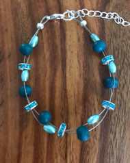Resell for 15.00 or more 7.5 inch floating bracelet plus extender Peacock blue wood/ light teal glass pearl/ crystal rondelle.  Made by Ashley Style #TWPFB070318