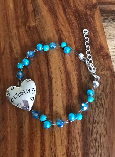 "Resell for 24.00 or more 7.5 inch floating bracelet plus 2"" ext chain Turquoise magnesite, teal crystal and teal glass pearls  Pewter charm says ""charity"" Style #TBCFB071318"