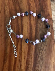 Resell for 15.00 or more 7.5 inch floating bracelet plus ext Genuine freshwater pearls purple/ lt purple glass pearls/ purple crystal Style #PPCFB071318