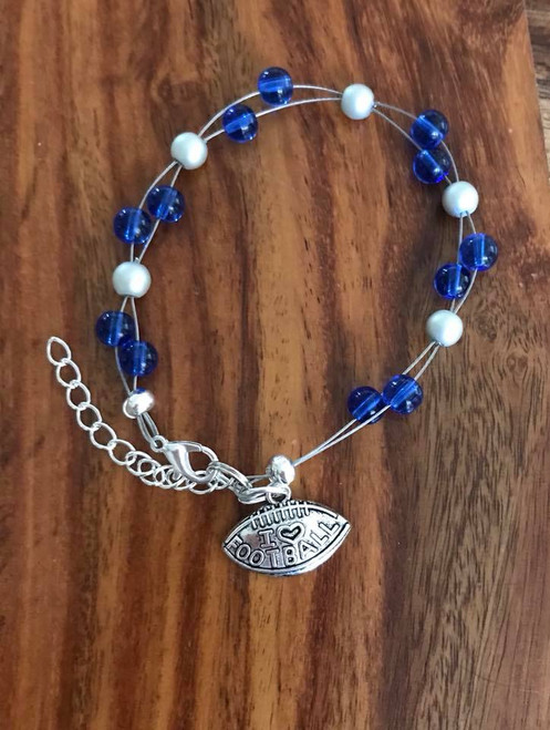 Resell for 18.00 or more 7.5 inch floating bracelet plus set chain I love football charm Team colors Detroit Lions blue silver Style #DLFB071318