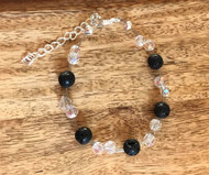 Lava floating bracelet 12.00 Resell for 36.00 or more  Use for aromatherapy *** do not get essential oils on anything besides the lava stone.   7.5 inch plus ext  Lava, crystal Made by Ashley  Style #LRFB071818
