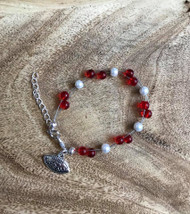 "**(not crimson)  3 available 6.00 Resell for 18.00 or more Floating bracelet 7.5 "" plus ext Glass beads I love football charm  Made by Ashley  Red white Nebraska Cornhuskers Style #RWHB072318"