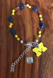 "Resell for 40.00 or more  7.5"" plus ext chain floating bracelet Official licensed M charm  Made by Ashley  University of Michigan football colors  Blue maize Style #UMOLFB072718"