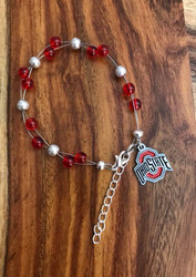 "Resell for 40.00 or more  7.5"" plus ext chain floating bracelet Official licensed Ohio State charm  Made by Ashley  Ohio State  football colors  Red grey Style #OSOLFB072718"