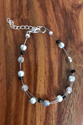Resell for 15.00 or more 7.5 inch plus ext chain  Floating bracelet Made by Ashley  Pewter, grey matte glass black crystal Style #DBFB080918