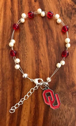 "Official licensed college charm  18.00 Resell for 40.00 or more 7.5"" plus ext chain floating bracelet Made by Ashley  Oklahoma Sooners team colors Style #OSOLFB081518"