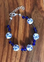 """Resell for 18.00 or more 7.5"""" plus extender chain floating bracelet  Ceramic blue and white beads blue glass Made by Ashley Style #BCFB081718"""