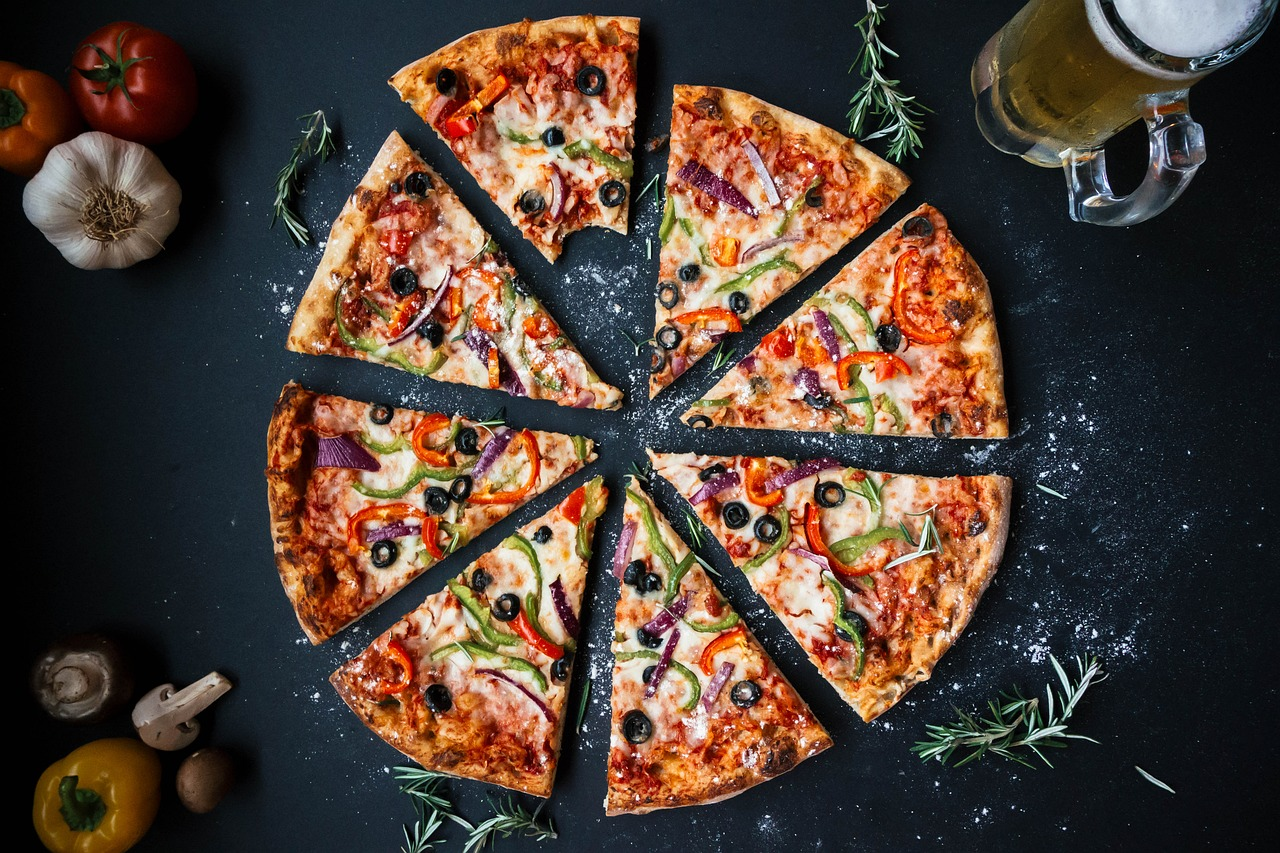 Photo of pizza and fresh vegetables