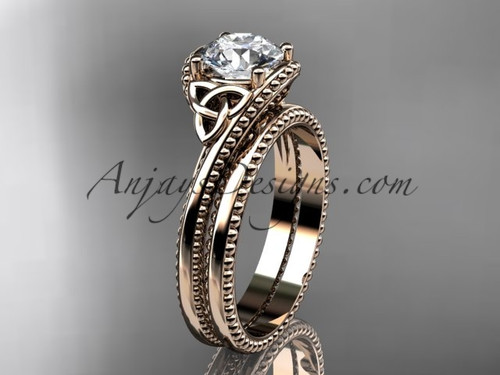 """14kt rose gold celtic trinity knot wedding ring, engagement set with a """"Forever One"""" Moissanite center stone CT7322S"""
