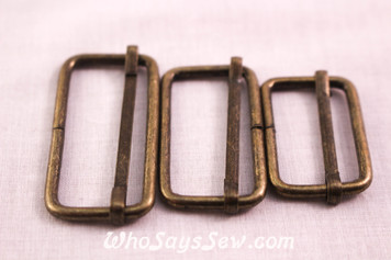 4 Adjustable Strap Sliders in Antique Bronze