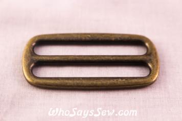 2 Alloy Strap Tri-Glides in Antique Bronze. 3.8cm wide.