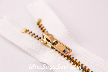 YKK Closed-Ended Gold Metal Zipper with Regular Pull.