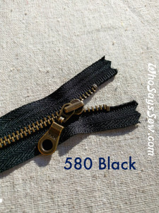 YKK Size 5 Closed-Ended Antique Brass Metal Zipper with Donut Pull in Black