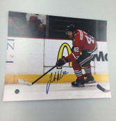 JOAKIM NORDSTROM - Chicago Blackhawks - Autographed 8x10 (Chasing Puck Fans in Backround)