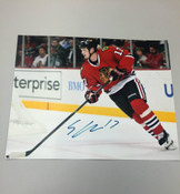 SHELDON BROOKBANK - Chicago Blackhawks - Autographed 8x10 (Chasing Puck)
